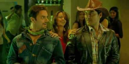two men dressed as cowboys winking at each other