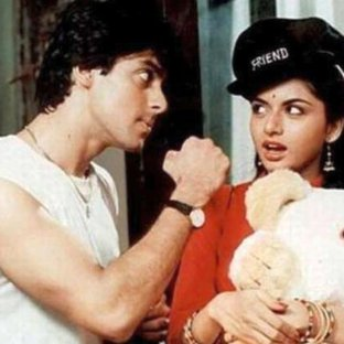 a man and woman looking at each other with man holding up a punch and the woman holding a teddy bear and having a shocked expression