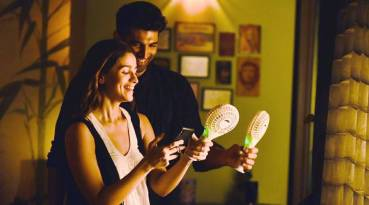 a man and a woman standing and smiling at their phones, in a still from he new movie sadak 2