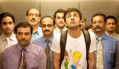 in a scene from the movie wake up sid, ranbit kapoor standing in an elevator with some people in background