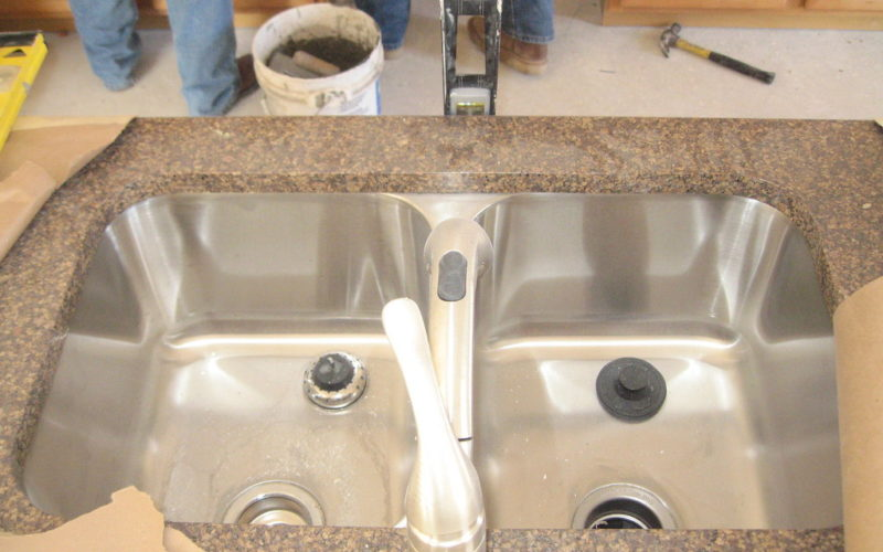 how do you attach an undermount sink to