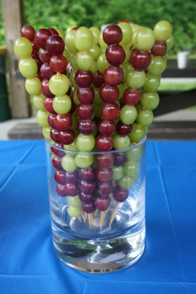 Grapes on a stick.  Kids love them and they look beautiful on your party table.