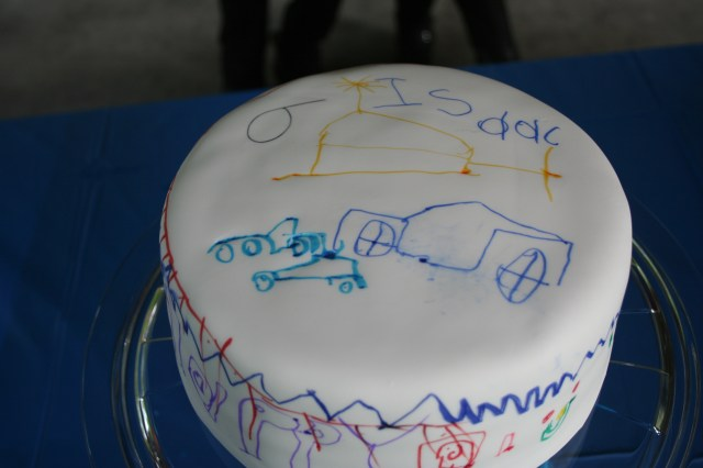 Cover a cake with white fondant and let your child decorate it themselves with non toxic markers!  You can use Crayola!