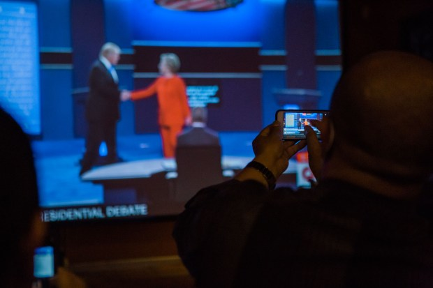 Members of the Nepali-American community gather at Himalayan Yak in Jackson Heights and take photographs of the first 2016 presidential debate on September 26, 2015. (The Ink/Gabriela Bhaskar)