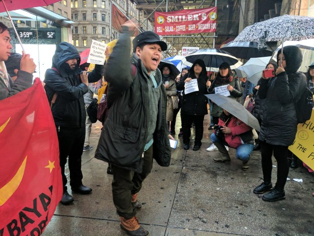 """""""We will never glorify the fascist dictator who plundered the wealth of the land and the people and committed many human rights violations."""" said Red Tirona, the vice chairperson of Anakbayan New York."""