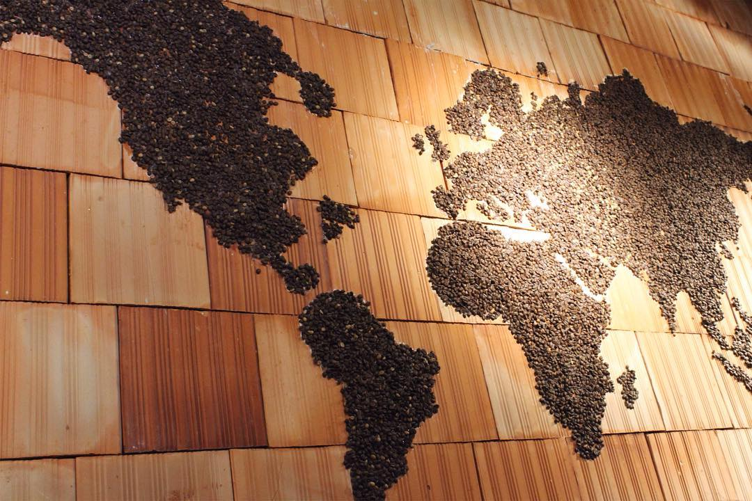 Coffee beans on a brick background