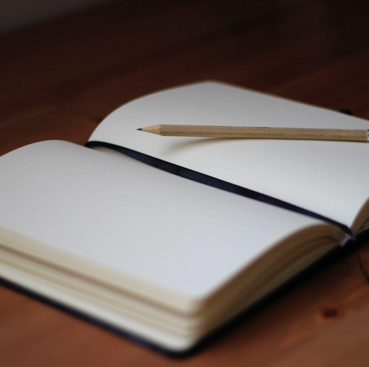 old notebooks out of context sentences Photo by jan kahanek on Unsplash
