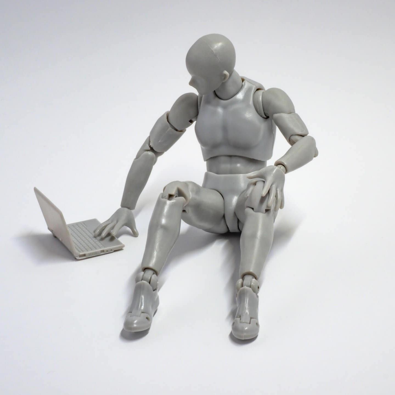 man action figure robot on a pc digital minimalism