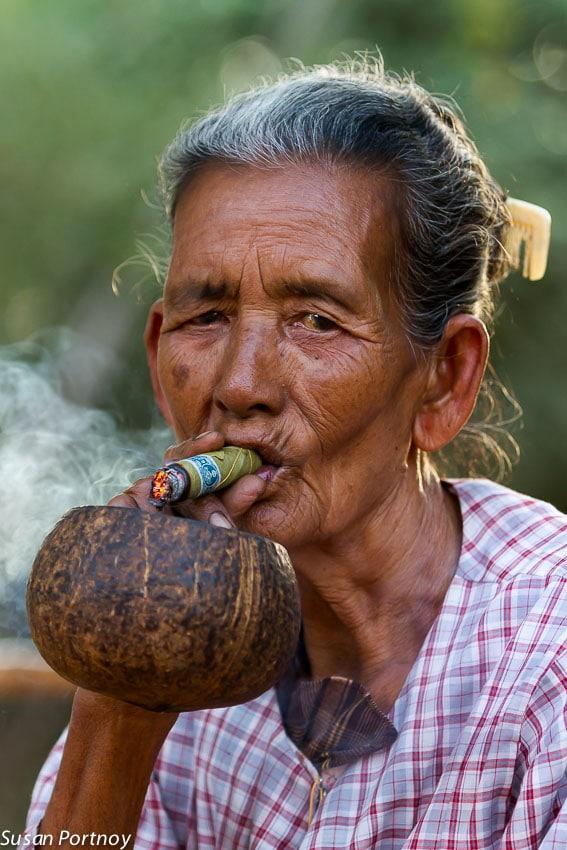 Woman smoking cigar in Bagan, Myanmar