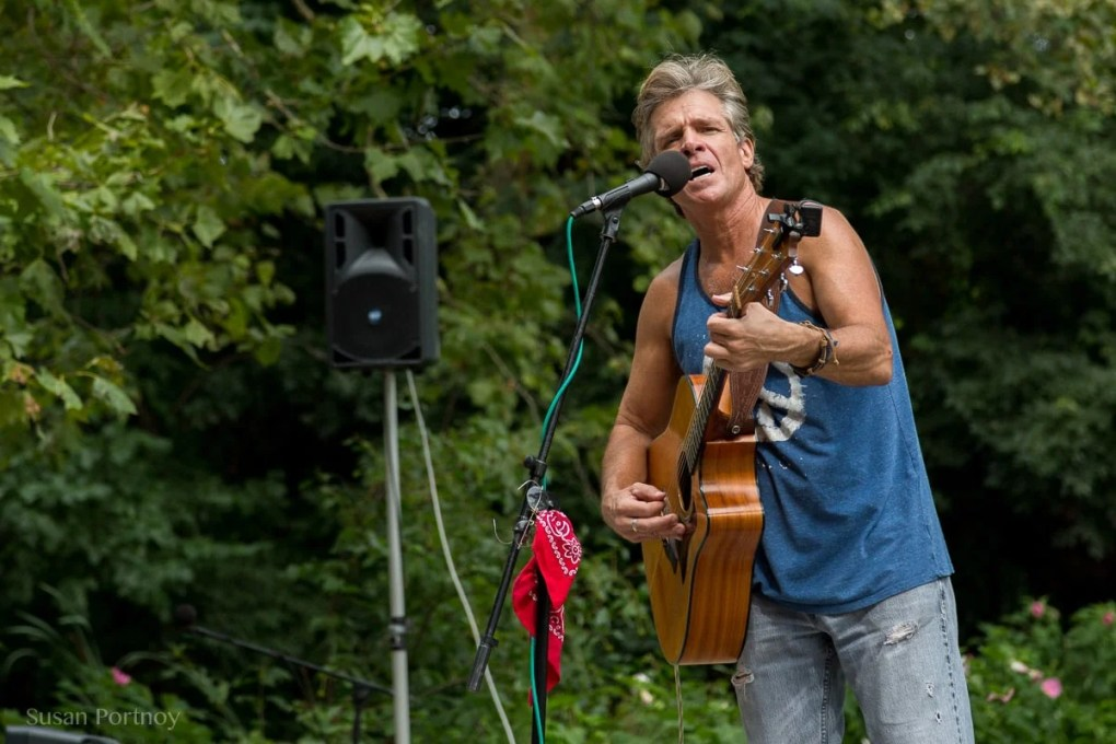 David Ippolito plays his guitar and sings in Central Park - The Insatiable Traveler