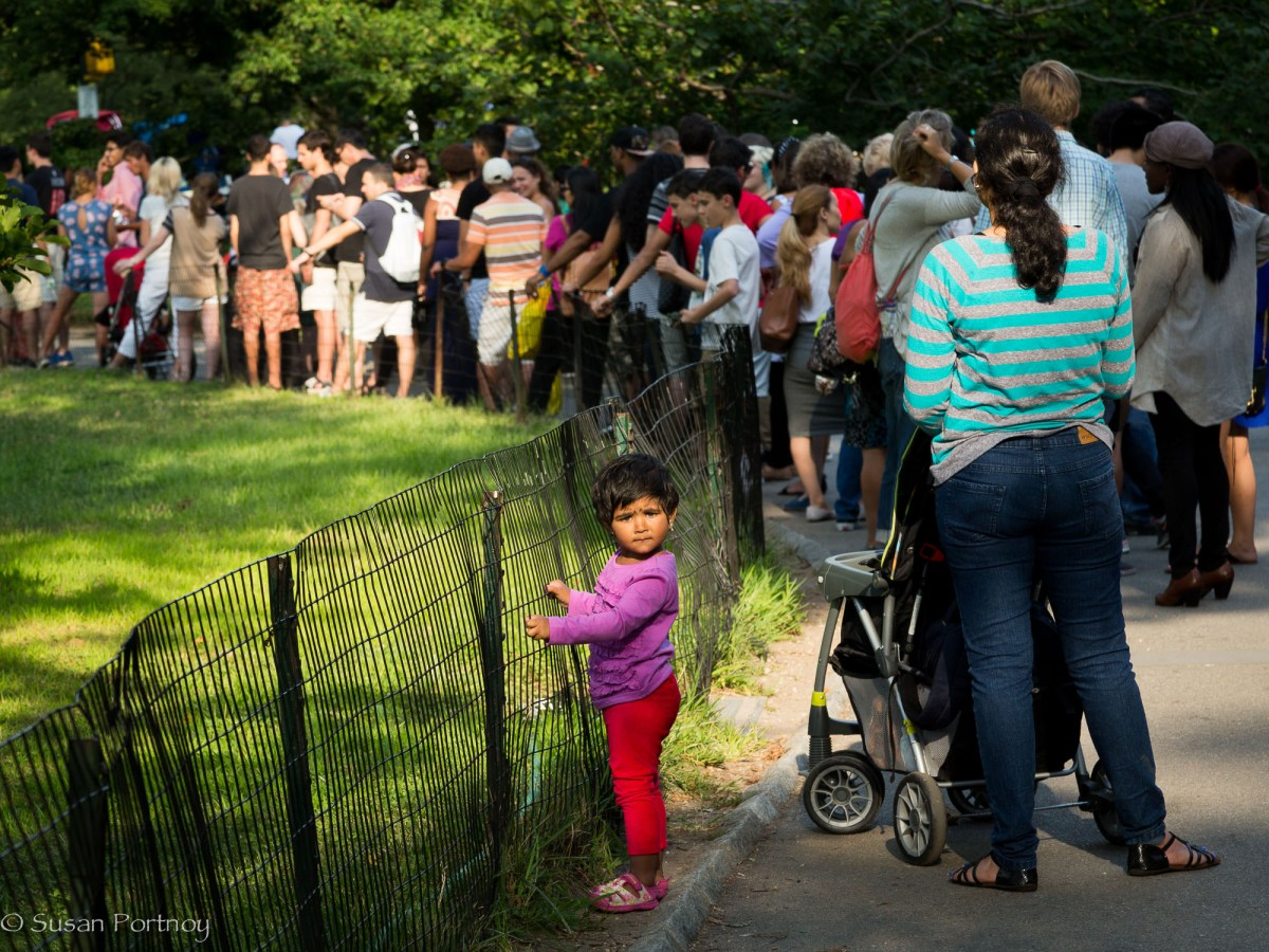 Little girl stands in line in Central Park