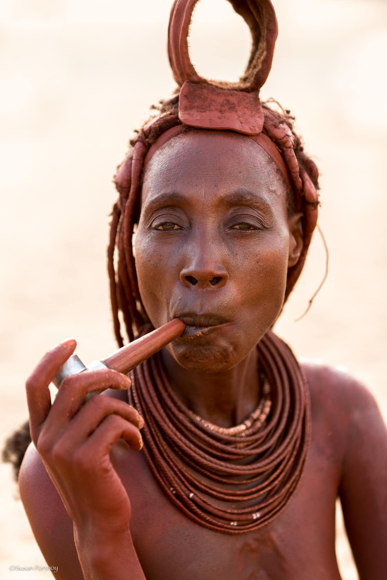 This is Krocodile.. the matriarch of the Himba village. She's 42 (we think) and has 10 children. You can see her youngest in the first image of this gallery