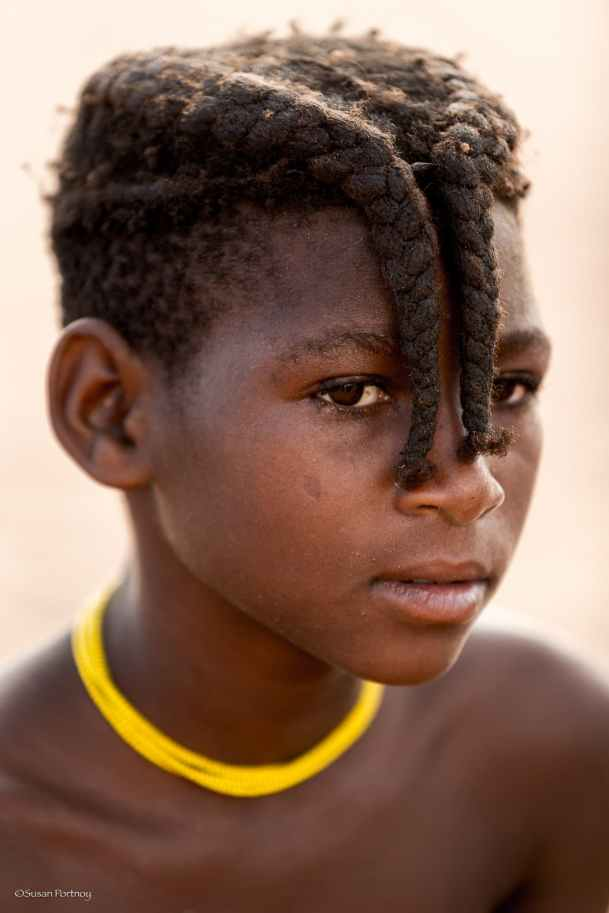 Prior to puberty, a young girl's hair is braided into this hairstyle - if she is a twin, she'll only sport one braid