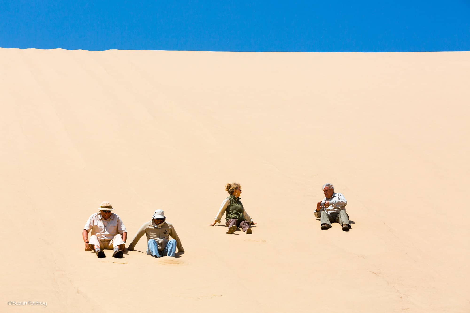 My camp-mates scooting down the dunes on their bottoms. I strategy I chose to avoid. They were shaking sand out of their shorts the rest of the day
