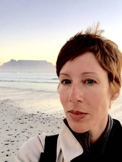 Selfie of Susan Portnoy with Cape Town's table mountain in the background