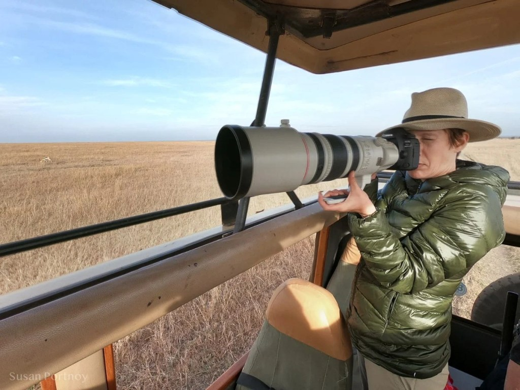 Susan Portnoy, the Insatiable Traveler, photographing in the Masai Mara - safari Packing List