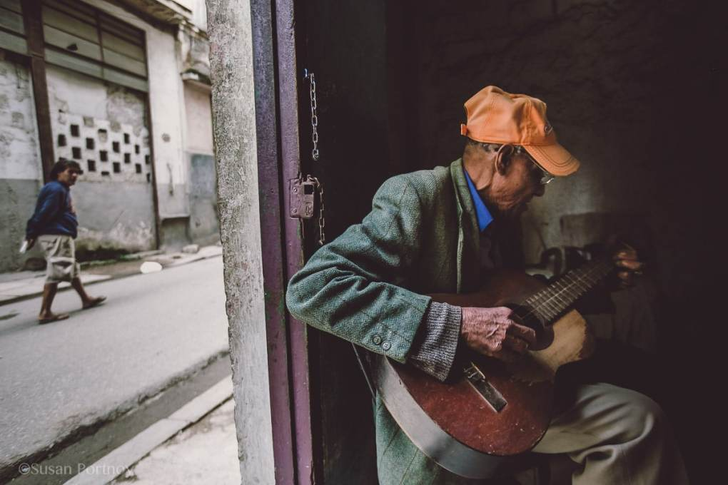 Local man in Havana, Cuba playing guitar