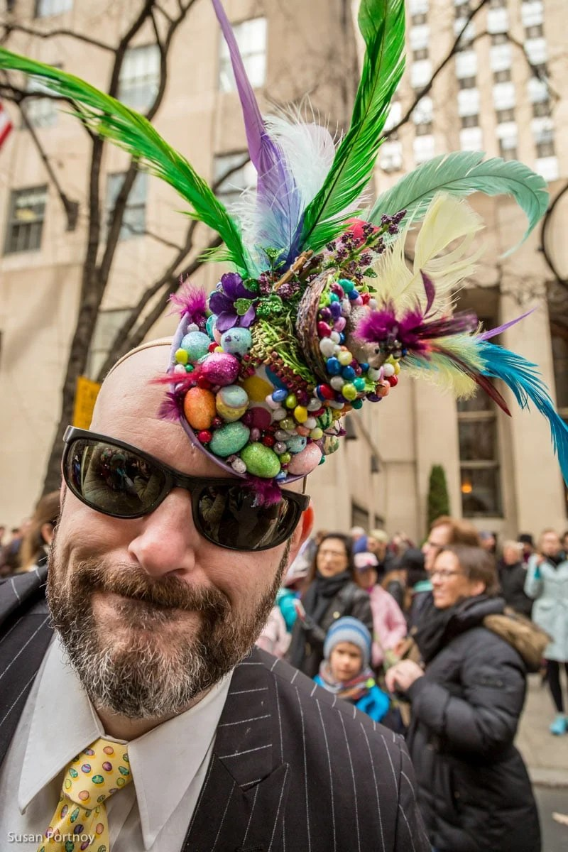 Man wearing easter egg hat costume in the Easter Parade NYC in 2016
