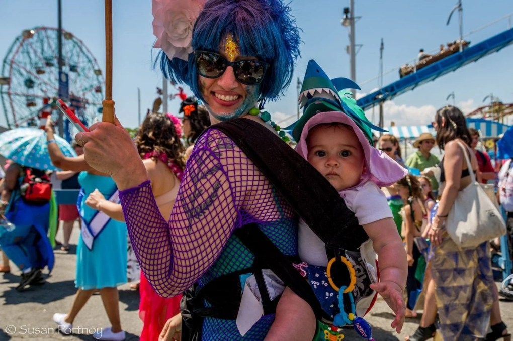 Woman and her baby walking in the Coney Island Mermaid Parade 2016