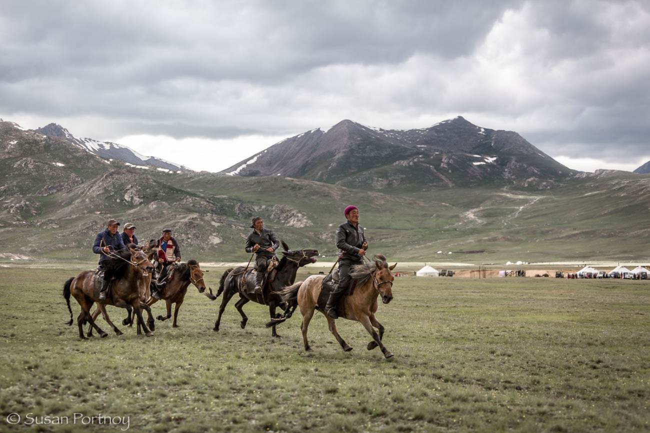 Kazakh riders race in the Altai Tavan Bogd National Park, Mongolia