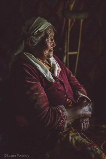 Old kazakh woman sitting in a chair in Mongolia