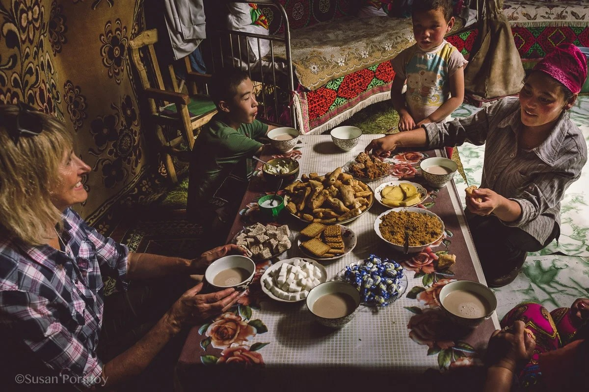 Having tea with a Kazakh woman and her children