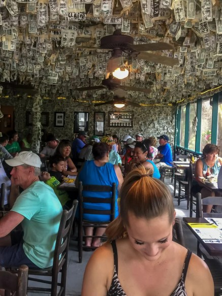 Back patio of the Cabbage Key Restaurant; dollar bills hanging from ceiling
