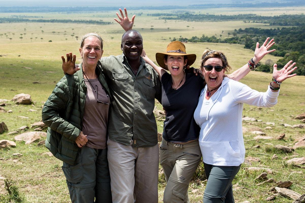 Four people happy in the Masai Mara / Insatiable Traveler