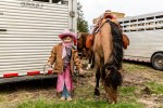 Little girl wearing pink chaps and cowboy hat with her pony in Darby, Montana at Triple Creek Ranch.