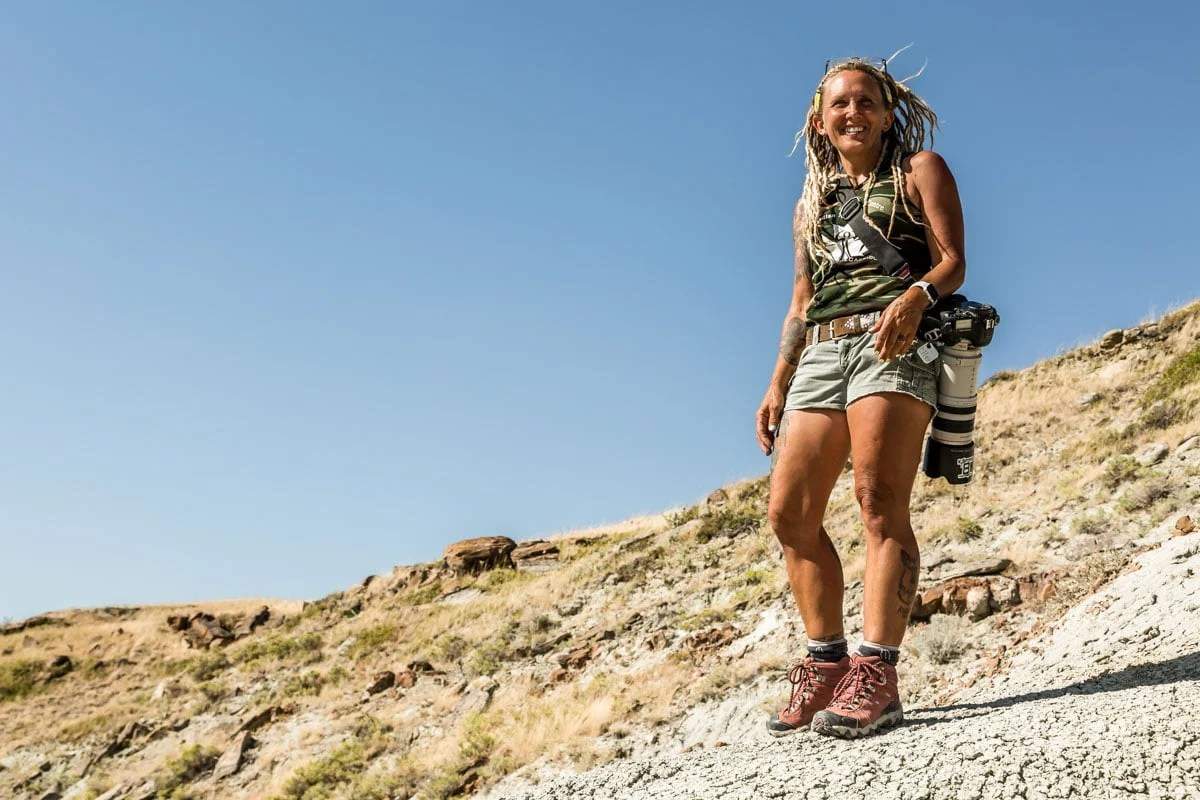 Wendy on hill, Finding Fossils with Wendy Sloboda- The Badland's Badass Dinosaur Hunter, Devil's Coulee, Alberta, CA-5420