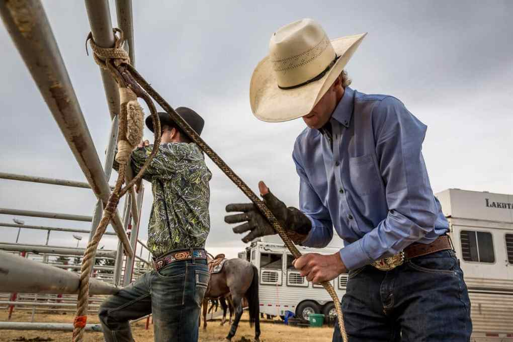 Cowboy working on his reigns for a rodeo