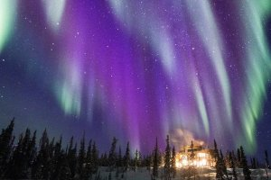 Aurora and the Main Lodge at Blachford Lake Lodge/ Photo: Martina Gebarovska
