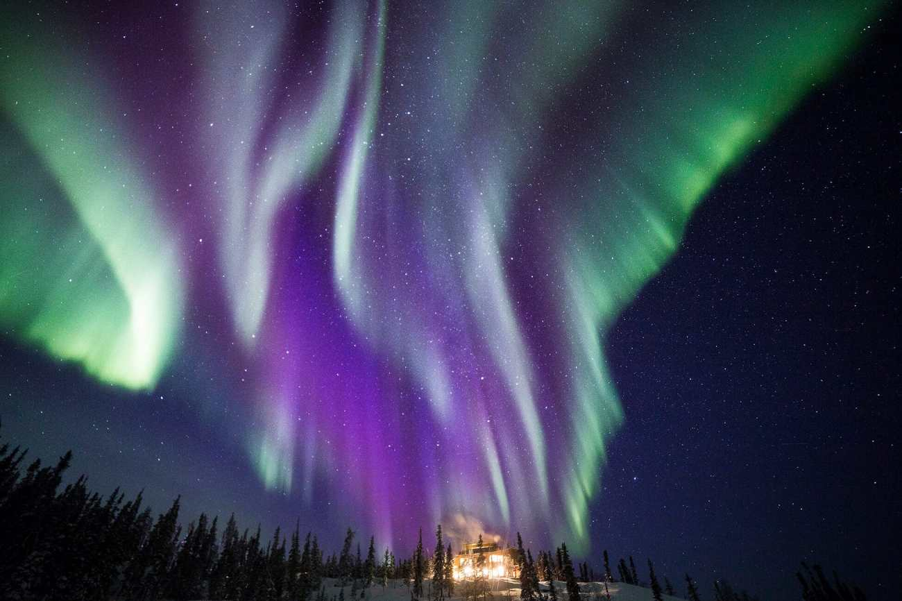 Aurora and the Main Lodge at Blachford / Photo: Martina Gebarovska ---10 of the Most Beautiful Places in Canada for Unforgettable Views