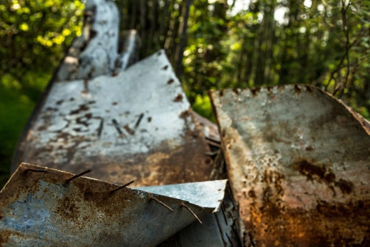 metal with rusted nails - Exploring Sternwheeler Graveyard Dawson City, Yukon