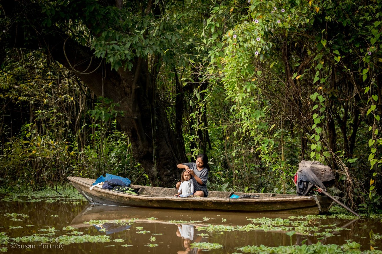 Woman in a boat | 6 Things to love about a luxury River Cruise on the Amazon -0855