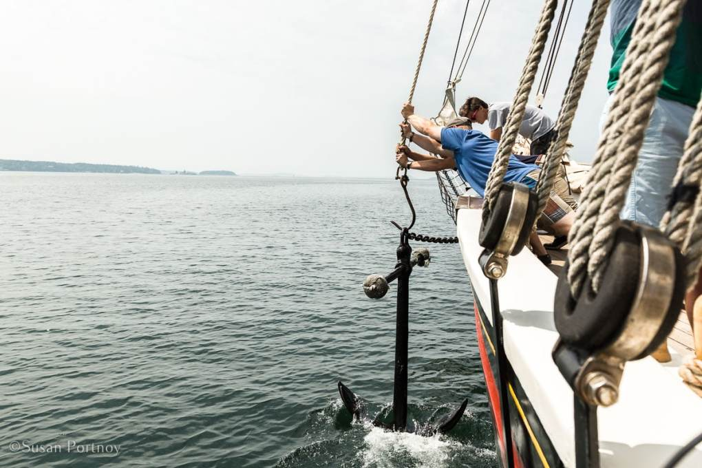 Guests and Crew raise the anchor of the J & E Riggin - Jon Finger, Ella Finger, Annie Mahle sing above the J & E Riggin-Windjammer cuise in Maine-559220180703