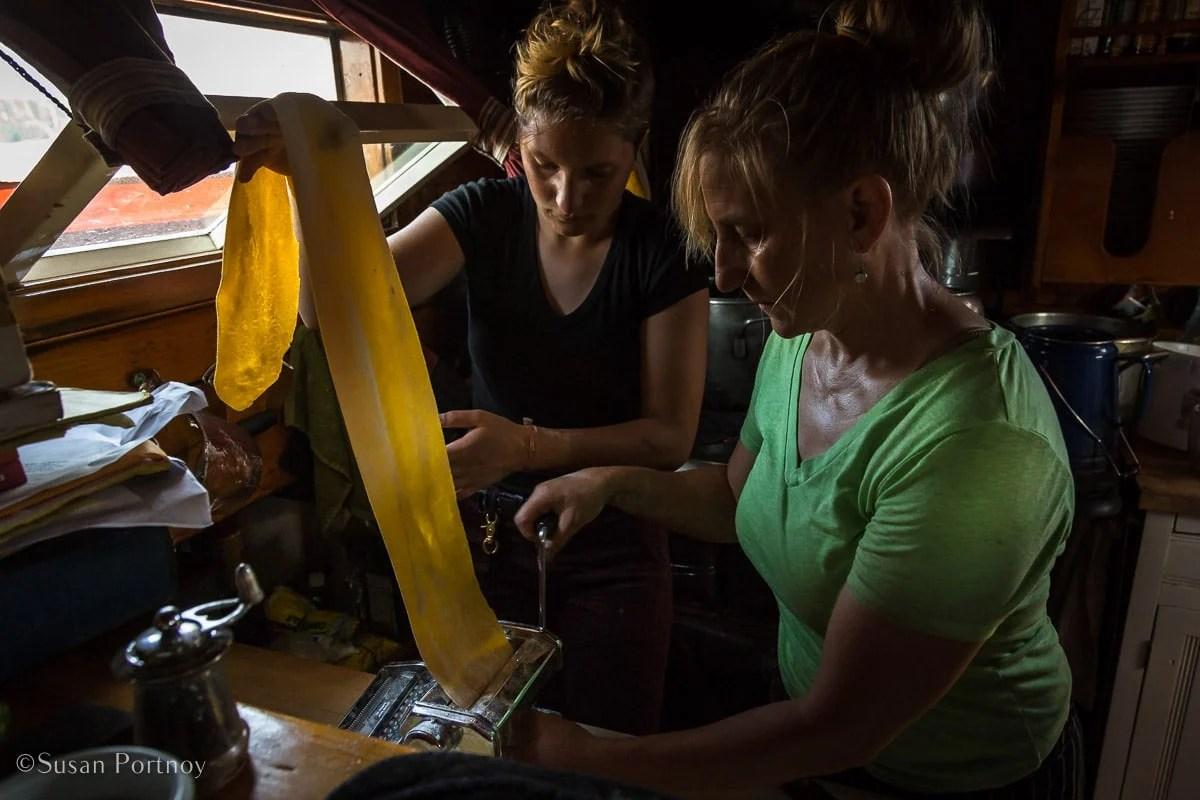 Annie Mahle & Ella Finger make pasta on the J & E Riggin - Windjammer cruise in Maine-580520180703