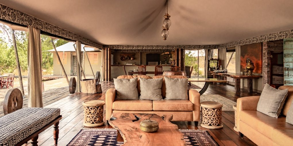 View to the lounge and dining room inside Mpala Jena's main tent.