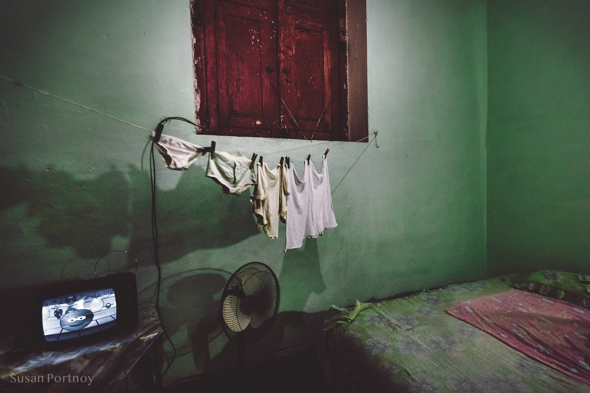 Laundry hanging on line inside a home in Havana Central