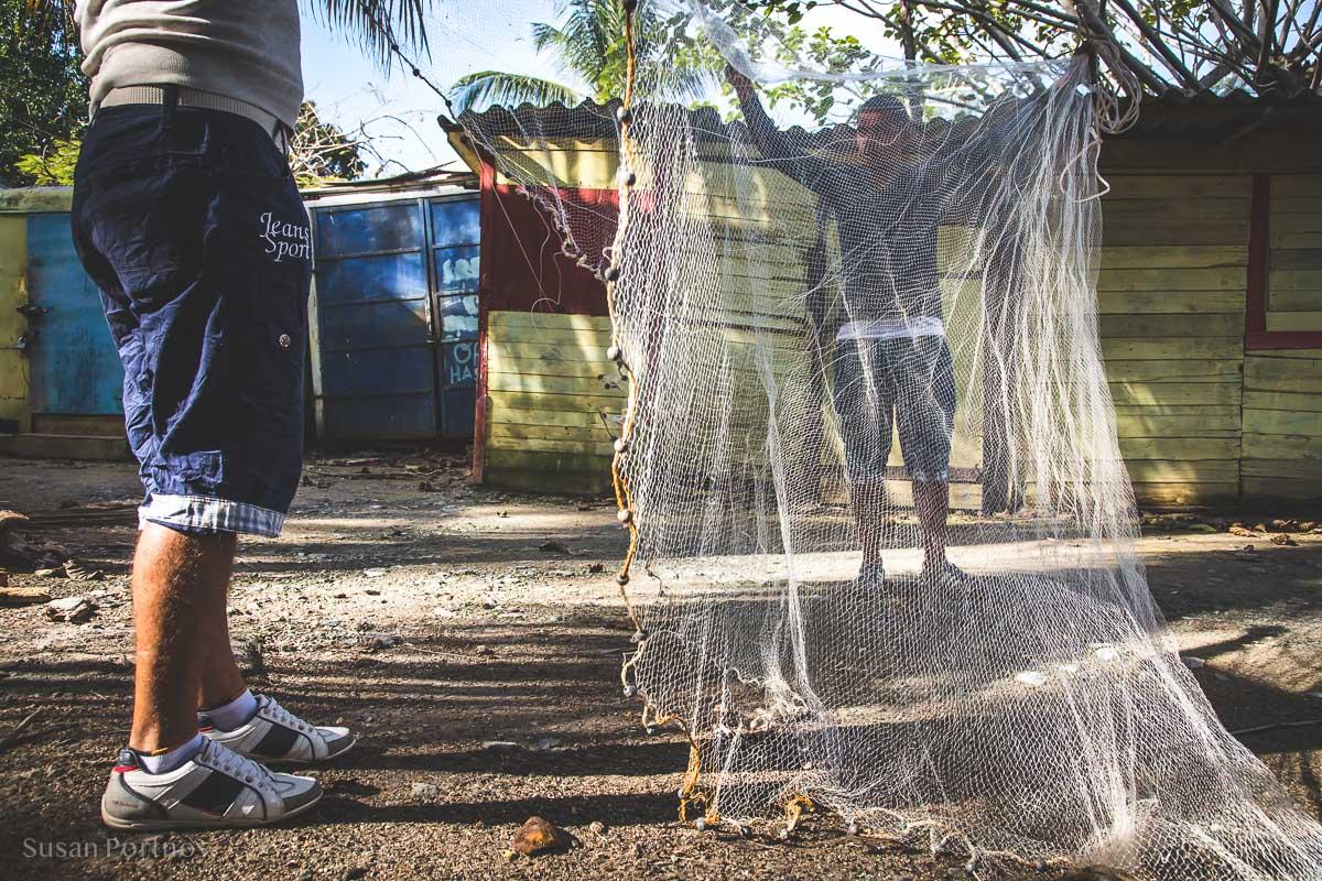 Fishermen working on a net in Cojimar, Cuba