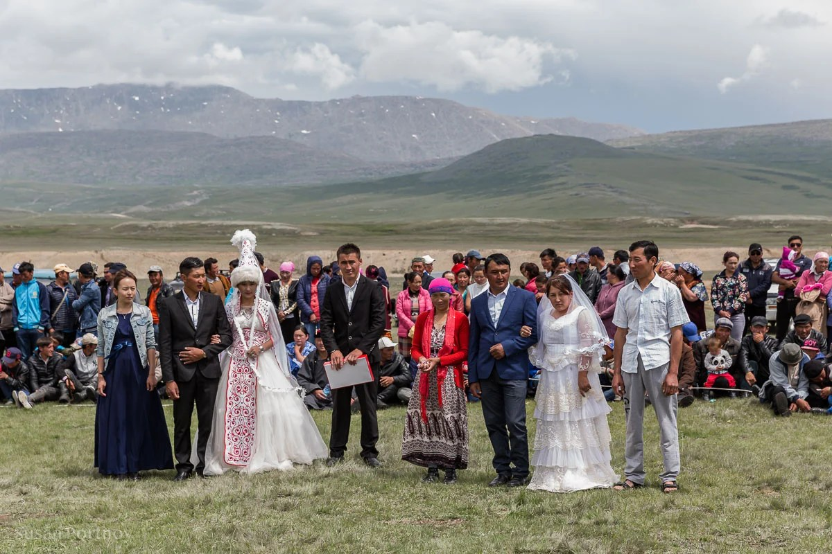 Kazakh wedding of two couples. Brides and grooms along with members of the family in the middle of a celebratory circle., Mongolia
