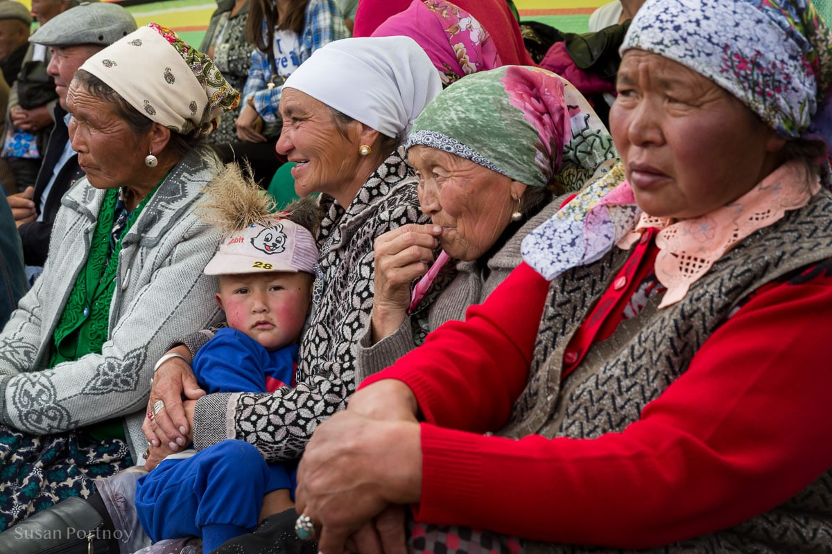 Grandmothers watch the wedding. A little girl sits on her grandmother's lap