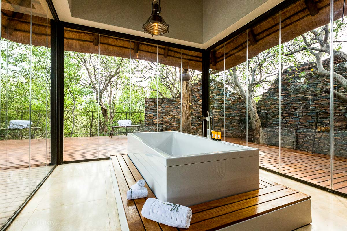 Glass enclosed bathroom at the Molori Safari Lodge