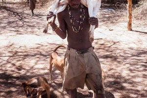 Hadzabe man with a goat in Tanzania