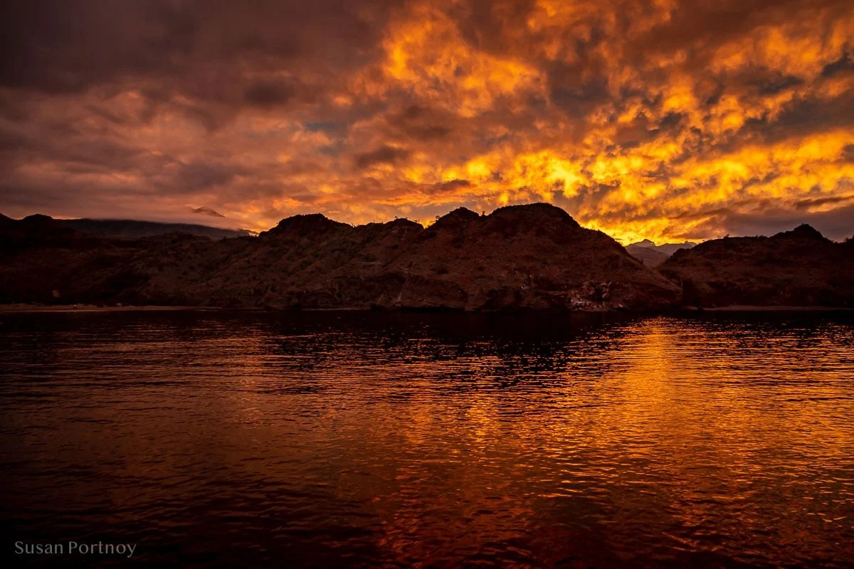 A fiery sunset over Agua Verde as seen from the Safari Endeavor sailing on the Sea of Cortez