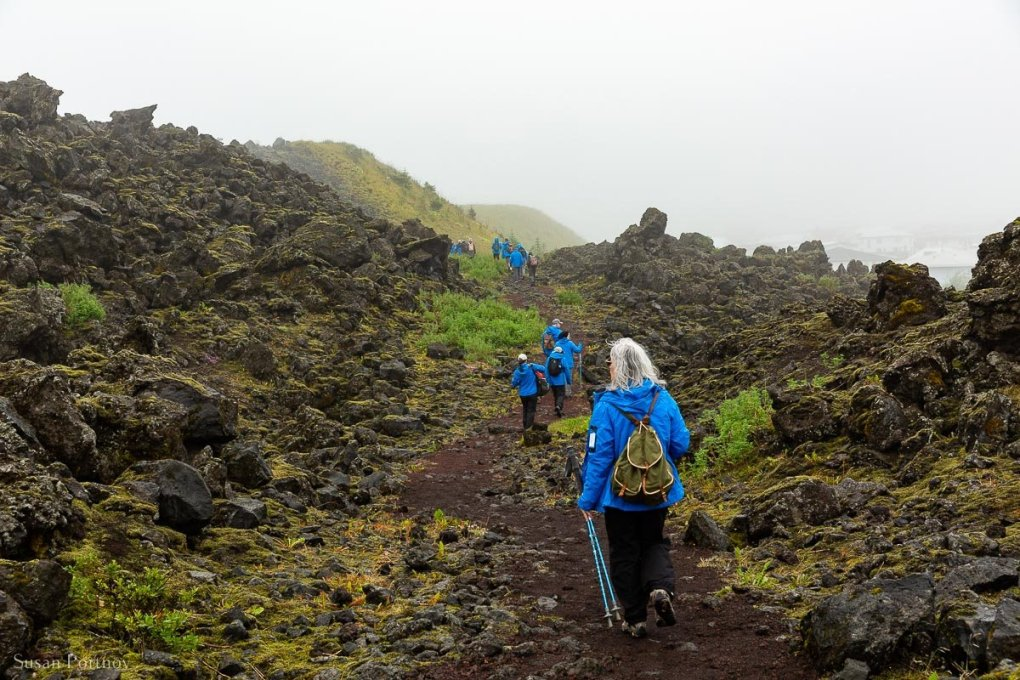 Passengers of the Ocean Endeavor hike the trail to the summit of Eldfell volcano in the Westman Islands, part of Iceland.