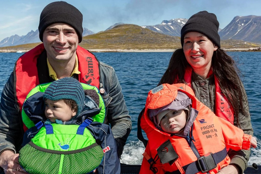 Nive Nielsen, her husband and their two children on a zodiac in Greenland