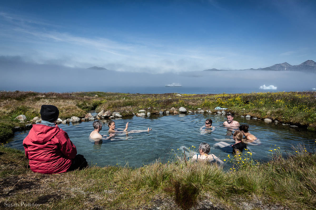 People soaking in the hot springs on Uunartoq Island in Greenland