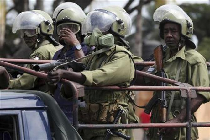 Image result for pictures of two Tanzanian policemen fighting