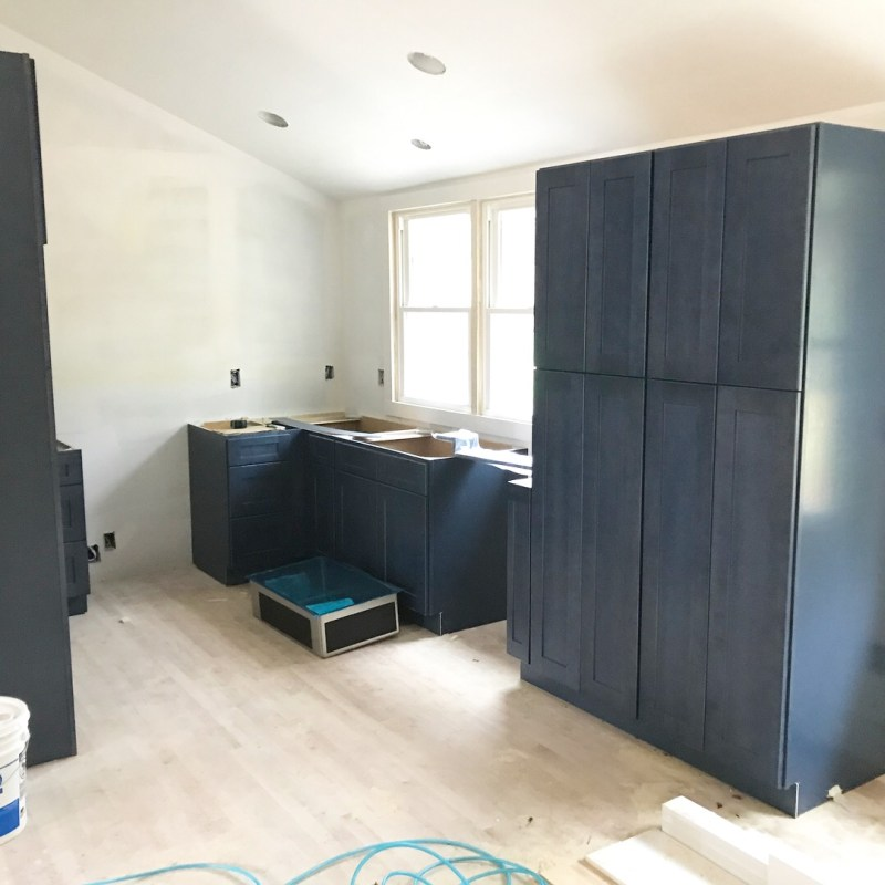 raleigh house flip renovation navy cabinets concrete lights flipping houses